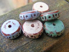 Dot and Dash Disc Beads - Faux Ceramic Series by Pips Jewellery Creation, via Flickr ... All antiqued with acrylic paint, sanded, sealed with Renaissance Wax and buffed!