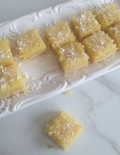 Gramma's famous Lemon Bars. Buttery shortbread crust with a delicious lemon filling! #recipe #thegoldlininggirl