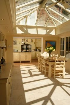 Love the patterns the lantern skylight plays with the evening light in this orangery kitchen extension.