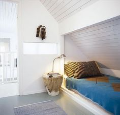 bunks tucked under the eaves - great for kids guest room