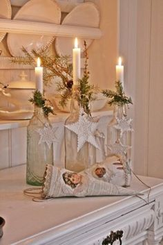 Easy Christmas Décor- hang any ornament and affix any kind of evergreen to the neck of any bottle (wine bottle, antique, etc.). Top with a tall dollar store candle. Good Ideas For You | Christmas Candles