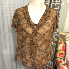 Leopard Print Short Sleeve Blouse Very pretty leopard print blouse. Button closure with draping detail. Short sleeves that gather at hem. Semi sheer.  East 5th Tops Blouses