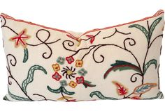 Custom pillow in vintage cotton crewelwork with solid white linen back.