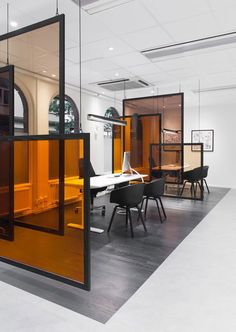 Sparbanken Rekarne -- use idea as desk dividers, angle desk spaces against incoming sunlight so the glass affects their desks & the space around it...