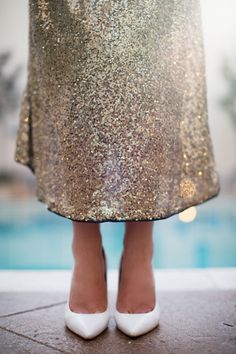 ::The Skinny Confidential talks skirts and shoes and black friday sales <<< how amazing is this gold midi skirt when paired with a thick striped top and white shoes::