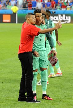 Cristiano Ronaldo of Portugal with a fan during the Uefa Euro Semi final between Wales and Portugal at Stade des Lumieres on July 6 2016 in Lyon. Soccer World, World Football, Portugal Euro, Cristiano Ronaldo Quotes, Portugal Soccer, Cr7 Wallpapers, We Are The Champions, Good Soccer Players, Football Love