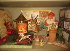 Revolving Econolite Christmas lamp, antique German reindeer and Santa candy containers, antique Santa Claus puzzle and German toys, collection of Benjamin Bradley 2015