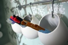 You could go cheaper and use mugs too...slide the handle through the bar and it's a stationary cute holder!