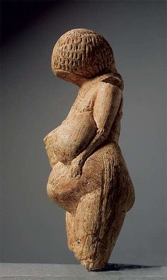Kostenki Venus 23000 - 21000 BC.  Spinners take note of her headdress - could it be a cap of spun fibers?