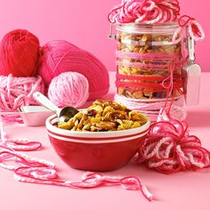 Curried Cranberry Snack Mix Recipe -Pack this easy-to-make munchie in a sleek glass or acrylic canister adorned with cotton yarn, and it'll be ready to put under the tree. Get that candy-cane brightness by winding yarn in shades of red and pink around the canister before topping with a homemade pompom. —Robin Haas, Cranston, Rhode Island
