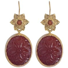 For Sale on 1stdibs - These stunning Bodhi Carnelian Earrings are made using hand carved carnelian, and capped with an exquisite hand engraved flower, embedded with carnelians.