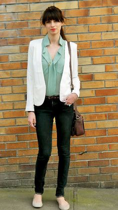 White blazer, mint-hued ruffled blouse, belted black skinny jeans, and nude ballet flats.