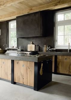 i love everything about this...thick concrete counter tops...rough cut wood cabinets...dark industrial elements tying it all together...just love it