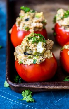 Tuna Stuffed Tomatoes are a great no-cook low carb dinner idea! These fresh tomatoes are stuffed with Taco spiced tuna salad. Taco Tuesday just got interesting! This is a Whole 30 Paleo compliant recipe, dairy Spicy Tuna Recipe, Tuna Recipes, Avocado Recipes, Paleo Recipes, Low Carb Recipes, Cooker Recipes, Seafood Recipes, Healthy Tuna, Healthy Snacks For Kids