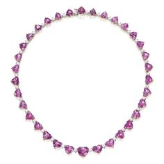 PLATINUM, 18 KARAT GOLD, PINK SAPPHIRE AND DIAMOND NECKLACE. Of graduated design, set with 34 heart-shaped pink sapphires weighing 77.37 carats, spaced by round diamonds weighing 3.76 carats, gross weight approximately 23 dwts, length 17 inches.