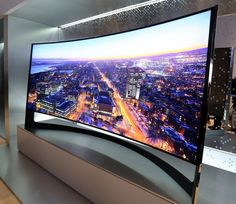 Samsung's is a curved, ultra high definition, television. The Ultra HD resolution is a benefit with a TV this size. In fact, due to the aspect ratio, the resolution is even greater than Ultra HD TVs: Futuristic Technology, Technology Gadgets, Tech Gadgets, New Technology, Energy Technology, Smart Tv, Smart Home, Tv Set Up, Capas Iphone 6