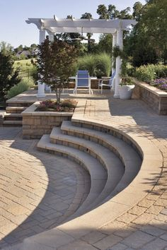 I like the curvy steps. This raised patio with a cabana is one of the 'outdoor rooms' in this back yard using Techo Bloc hardscape materials. Patio Steps, Garden Steps, Backyard Patio Designs, Backyard Landscaping, Terraced Landscaping, Terraced Backyard, Landscaping Ideas, Cabana, Pergola