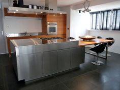 Arclinea Convivium Inox with Teak wood