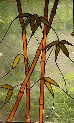 Bamboo. Stained glass panel. haha! can't believe I found this. I made this one as my first leaded piece! I used clearer glass for the bamboo and raindrop for the clear. very nice piece to make.