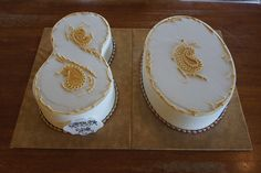 Number 80 shaped birthday cakes with gold paisley detailing