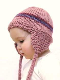 knit baby hat with earflaps. This would be so cute with a pom-pom on top!