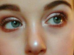 Warm cinamon dramatic eye with strong brows.......
