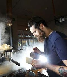Barista Sean McManus makes coffe at Single Origin, Surry Hills, during the morning rush. Photo by Brianne