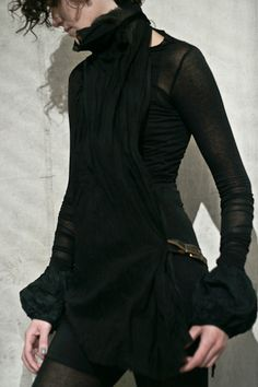 I love the ends of the sleeves and the flow of the scarf.  Might have to diy this!