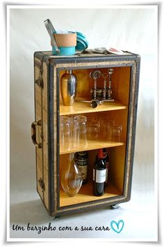 Old vintage suitcase repurposed into a bar. I love this idea. Not necessarily for a bar but what a great display case or shelf.