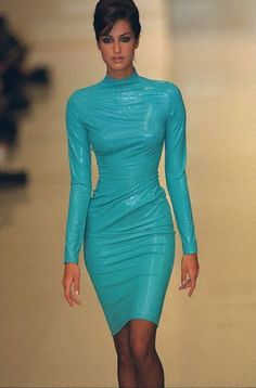 Yasmeen Ghauri, early 90s.  I can't believe I have a royal blue dress like this made out of suede with a leather waist. It has a peplum at the bottom of the low cut out back.  I love this dress...and when I used to be this skinny.
