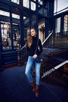 Draw attention to your favourite jeans by wearing them with a simple plain turtleneck like this black one worn by Kenza Zouiten. To recreate this cute and casual look, wear faded denim with tan leather boots and a miniature cross body bag. Brands Not Specified.