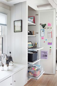 A pantry is transformed into an accessible kitchen home office with the addition of pull-out shelves, clear baskets and a magnet board to corral notes and supplies,