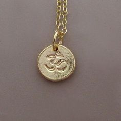 Tiny 14k Gold Om Ohm Necklace  Pebble by esdesigns on Etsy