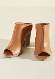Let these faux-leather mules be your liaison for a loving relationship with your city. The faux-stacked block heels and peep toes of this pair are your inspiration for always being out and about - oh, and their butterscotch hue? That was strategically placed to further woo your favorite part of town!