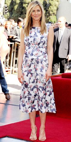 FEBRUARY 22, 2012 Aniston received her star on the Hollywood Walk of Fame in a floral Chanel dress, gold hoops and strappy sandals.