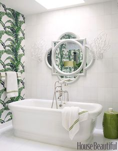 Tropical and Modern Bathroom  Designer Christina Murphy chose tropical green instead. With fern wallpaper and sunlight streaming in from a skylight above the tub, it reminds us of a tropical rain forest.