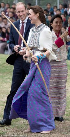 Duchess of Cambridge and Prince William react are taking part in archery at Thimphu's open-air archery venue