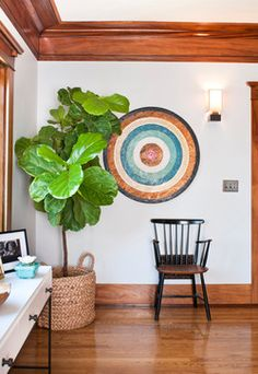 Like the fiddle-leaf fig and dart board.  Would work good at the end of my dining room by the back door.
