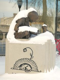 Staff photo by Clay Schuldt The statue of Wanda Gag and her cat sported a coating of snow on Saturday outside the New Ulm Public Library. New Ulm, Markers, Public, Clay, Snow, Statue, Clays, Sharpies, Sharpie Markers