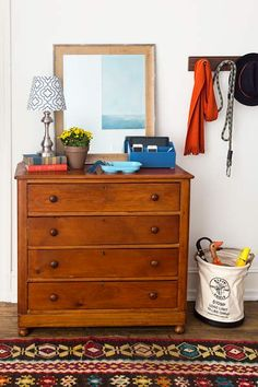 Use a dresser to help organize an entry area. Stash gloves, hats, and other outdoor accessories in the drawers. Keep a mirror on top for a look before heading out the door. | Photo: Burcu Avsar