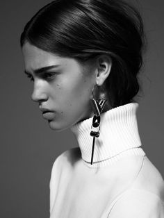 complex jewelry and polo neck