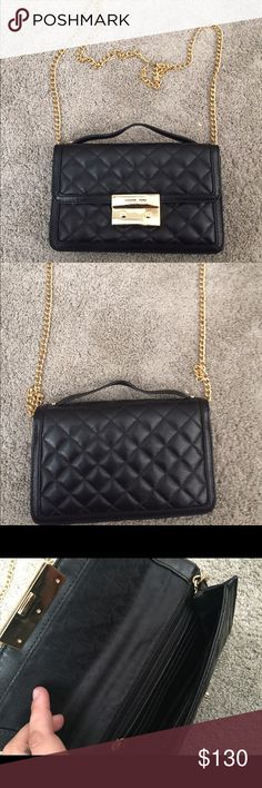 Michael Kors authentic purse A beautiful quilted Michael Kors purse used a few times. Beautiful bag, but just not reaching for it ! A few scratches on hardware on front of bag Michael Kors Bags Shoulder Bags