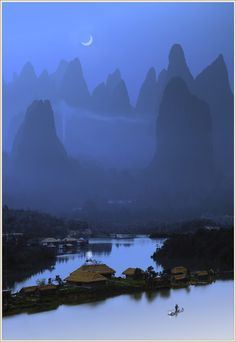 China: Gazing through mist at a slender bite of crescent moon. Just lovely.