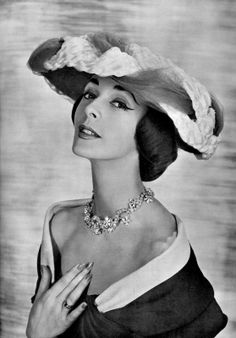 Kouka Denis in hat by Claude St. Cyr, dress by Nina Ricci, necklace by Francis Winter, photo by Georges Saad, 1956