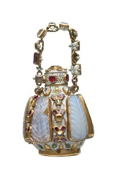 Gold scent bottle enamelled white and set with opaline chalcedony plaques, rubies, spinels and diamonds, with a gold suspension chain. Part of the Cheapside Hoard.