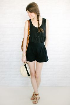 black buttoned tank tucked into black shorts- faux romper