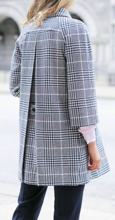 navy and pink glen plaid coat with back pleats and button detail, pale pink cable knit cashmere pullover, untucked button down shirt + classic navy trousers