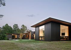 Carlton clads North Carolina home in dark cedar and weathering steel