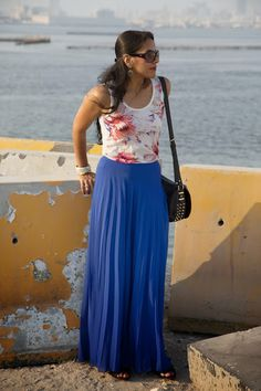 Floral top, pleated maxi skirt.
