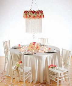 stack a pair of floral foam wreaths and affix with hot glue & floral pins. Then secure strands of crystal garland to the wreaths with more floral pins. Finish up by adding lush blossoms in your choice of color all around to hide your work! It'll be chandelicious!